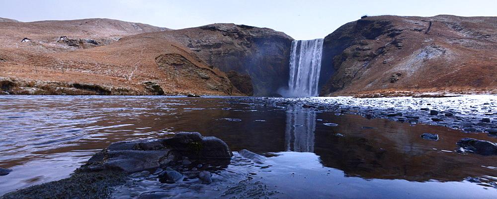 Skogafoss waterfall with reflection, Iceland, Polar Regions