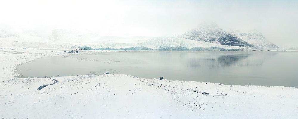 Fjallsarlon Ice Lagoon overlooking Fjallsjokull Glacier during snowstorm, Iceland, Polar Regions