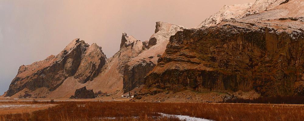 Panorama of mountain range and farm at sunrise, Iceland, Polar Regions