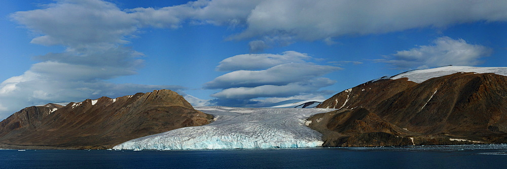 Panorama image of glacier fingers coming down to seashore, Nunavut and Northwest Territories, Canada, North America