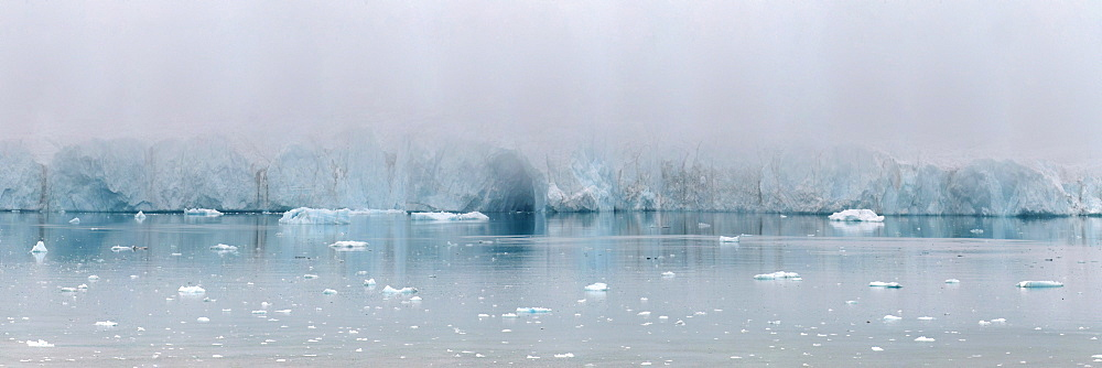 Glacier face in early morning fog, Nunavut and Northwest Territories, Canada, North America