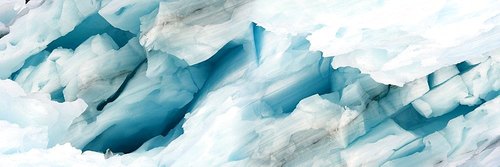 Panorama image of iceberg carved by wind and water