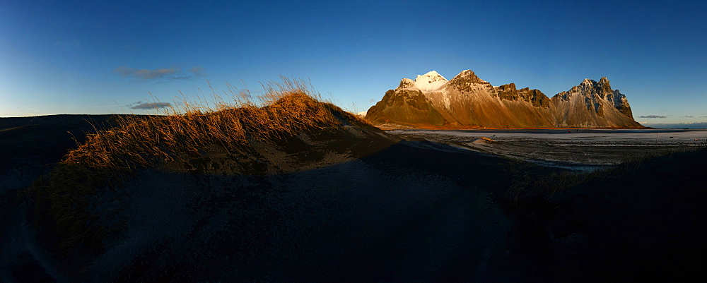 Vestrahorn mountain with black sand dunes in the front