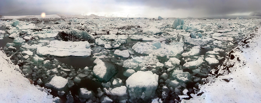 Icebergs from nearby glacier float in ice lagoon on its way to the sea, Iceland, Polar Regions