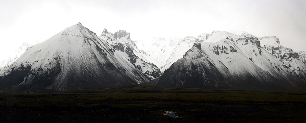 Panorama of snow covered mountain range in the south of Iceland