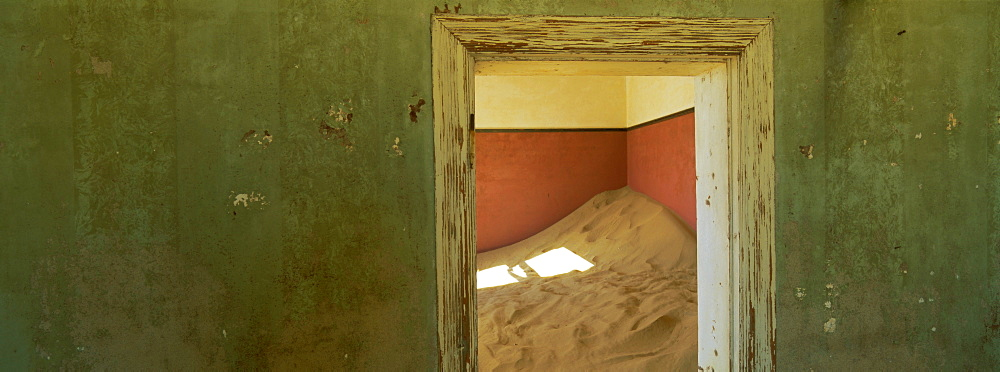 Interior of German house in the deserted mining town of Kolmanskop in the Restricted Diamond area on the south west coast, near the town of Luderitz, Namibia, Africa
