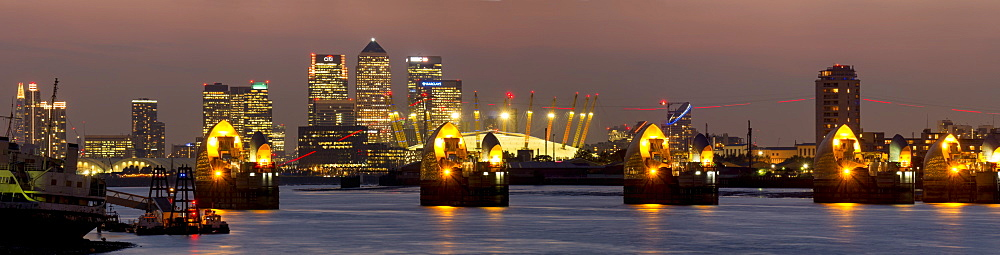 Thames Flood Barrier with Docklands and Canary Wharf panorama from Woolwich, London, England, United Kingdom, Europe