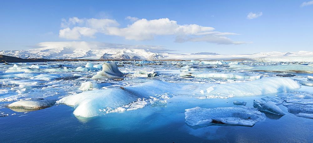 Panorama of mountains and icebergs locked in the frozen water, Jokulsarlon Iceberg Lagoon, Jokulsarlon, South East Iceland, Iceland, Polar Regions
