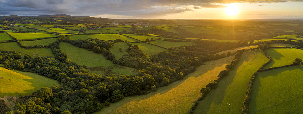 Aerial view by drone of rolling Devon countryside at sunset, Devon, England, United Kingdom, Europe