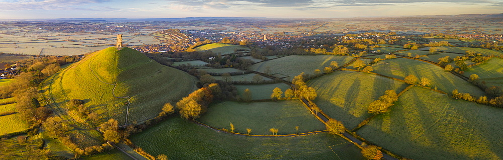 Aerial view by drone of Glastonbury Tor on a frosty morning on the Somerset Levels, Somerset, England, United Kingdom, Europe
