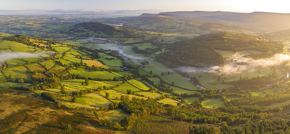 Aerial view by drone of mist floating over the Usk Valley at dawn, Brecon Beacons National Park, Powys, Wales, United Kingdom, Europe