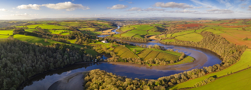 Aerial vista by drone of the River Dart meandering through rolling countryside, Devon, England, United Kingdom, Europe