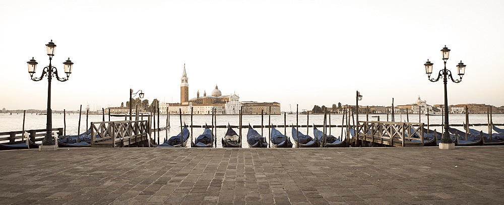 Gondolas moored on the Lagoon, San Giorgio Maggiore beyond, Riva degli Schiavoni, Venice, UNESCO World Heritage Site, Veneto, Italy, Europe - 808-1258