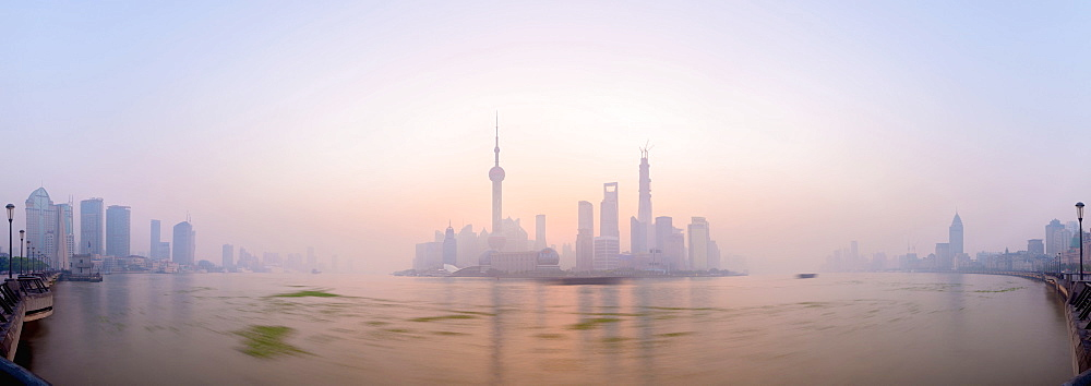 Pudong skyline across Huangpu River, including Oriental Pearl Tower, Shanghai World Financial Center, and Shanghai Tower, Shanghai, China, Asia