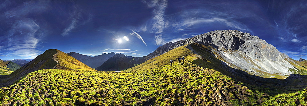 360° mountain panorama with hikers in the Wettersteingebirge range, Mt. Suedwand on the Suedwandsteig trail with view and Wettersteinmassiv mountains in Leutasch, Tyrol, Austria, Europe