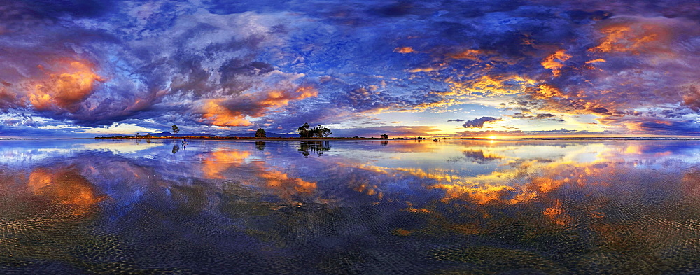 360 x 170 panorama with glorious sunset at Carters Beach, cloudy sky, Water Reflection, Westport, West Coast, Southland, New Zealand, Oceania