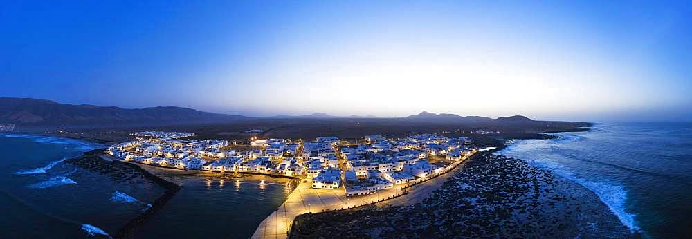Caleta de Famara at dusk, drone shot, Lanzarote, Canary Islands, Spain, Europe