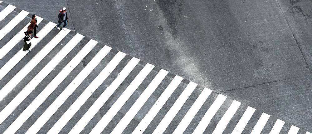 Shibuya Crossing, intersection, three people cross long crosswalk, Shibuya, Udagawacho, Tokyo, Japan, Asia
