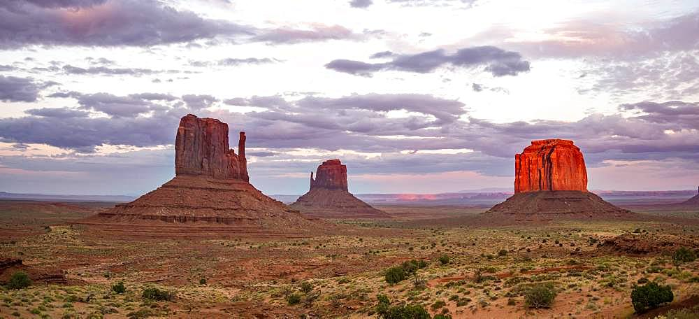 Red glowing rock formation at sunset, Table mountains West Mitten Butte, East Mitten Butte, Merrick Butte, Monument Valley, Navajo Tribal Park, Navajo Nation Reservation, Arizona, Utah, USA, North America
