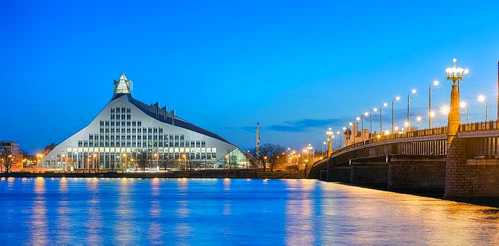 Bridge over Duena River with National Library at dusk, Riga, Latvia, Europe