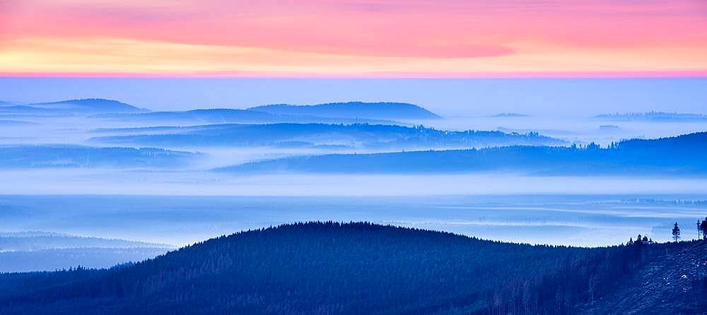 Sunrise on the Brocken, view over hills and forests with valley fog, Harz National Park, Saxony-Anhalt, Germany, Europe