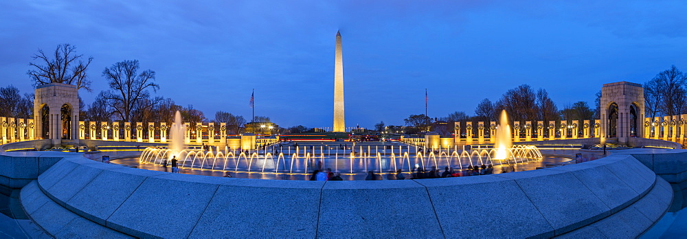 View of the Washington Memorial and World War Two Memorial illuminated at dusk, Washington, D.C., United States of America, North America