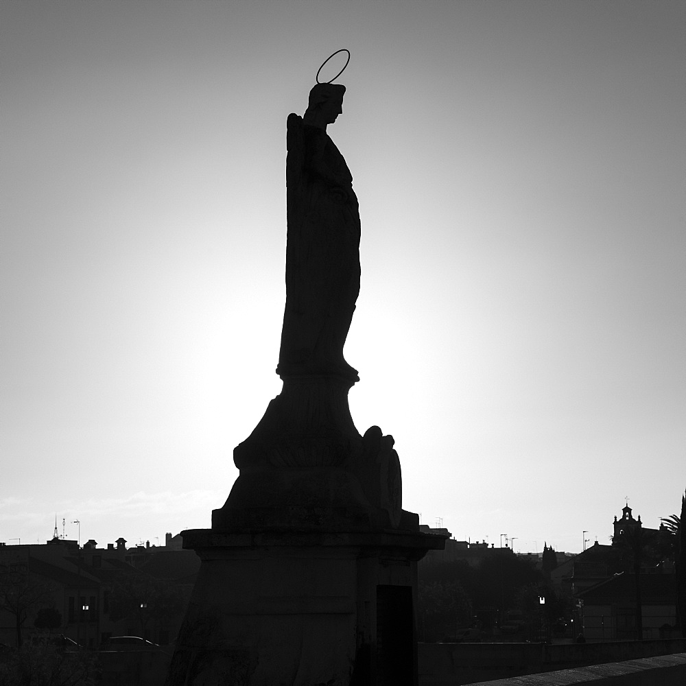 Silhouette of a statue, Roman bridge of Cordoba, Cordoba, Andalusia, Spain
