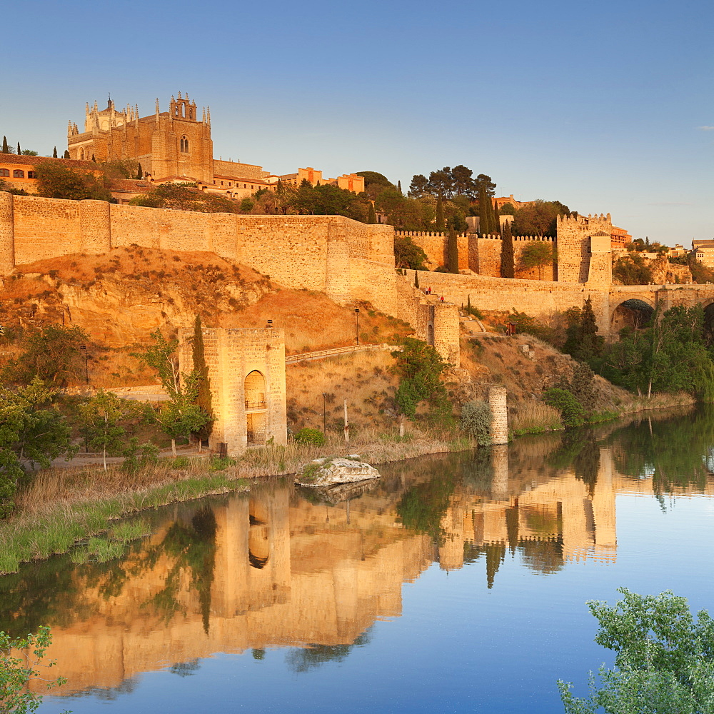 San Juan des los Reyes Monastery and town wall reflected in the Tajo River, Toledo, Castilla-La Mancha, Spain, Europe