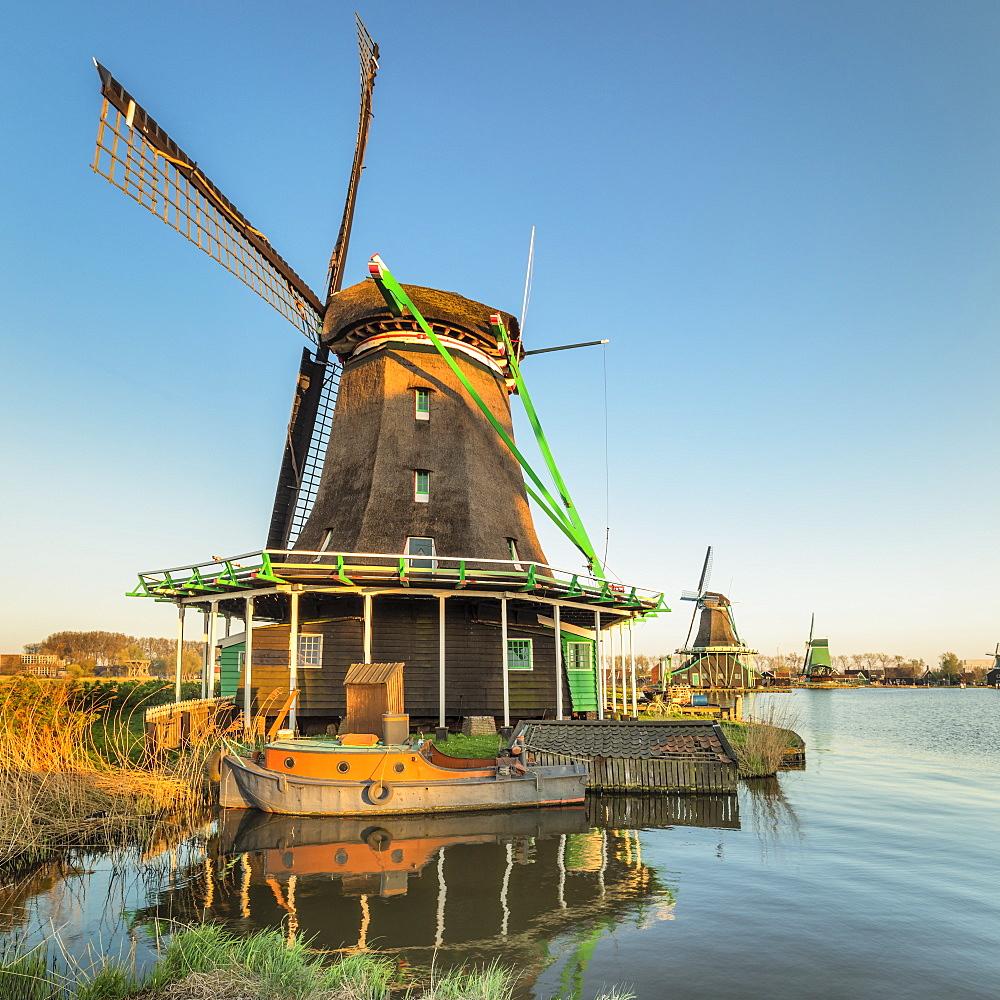 Windmill and boat on Zaan River, open-air museum, Zaanse Schans, Zaandam, North Holland, Netherlands, Europe - 1160-4323