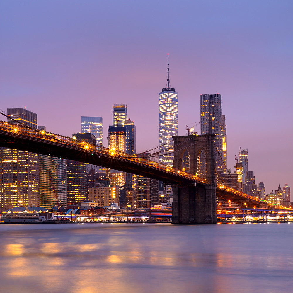 Brooklyn Bridge and Lower Manhattan skyline at dawn, New York City, New York, United States of America, North America