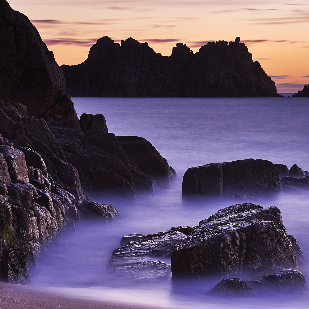 Early morning on the beach looking out towards Logan Rock at Porthcurno, Cornwall, England, United Kingdom, Europe - 1295-272