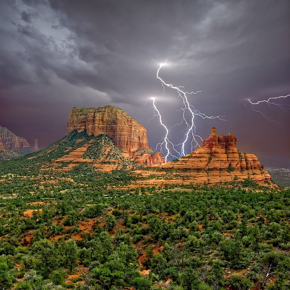 Lighting striking in between Courthouse Butte and Bell Rock near Sedona Arizona.