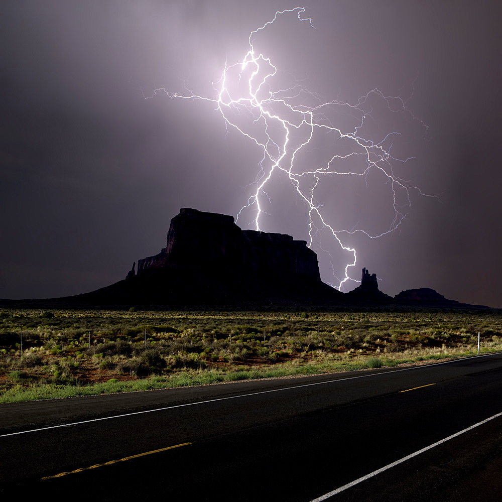 Composite photo of lightning striking behind Eagle Mesa off of Hwy 163 near Monument Valley UT. Taken in 2016.