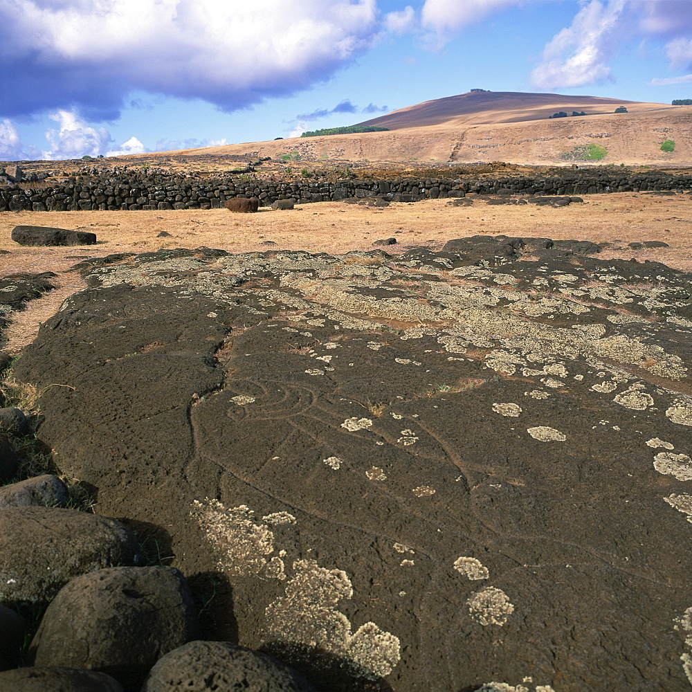 A petroglyph on rock at Ahu Tongariki on Easter Island (Rapa Nui), Chile, South America