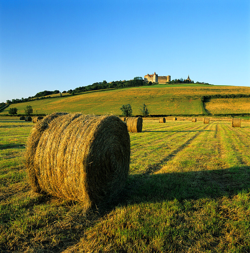Hay bales below the Chateau, Chateauneuf, Burgundy, France, Europe - 846-479