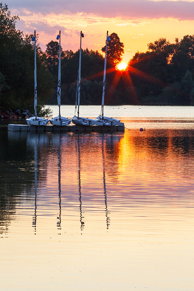 Boats by a pontoon during sunset at Bray Lake, Berkshire, England, United Kingdom, Europe - 10-408