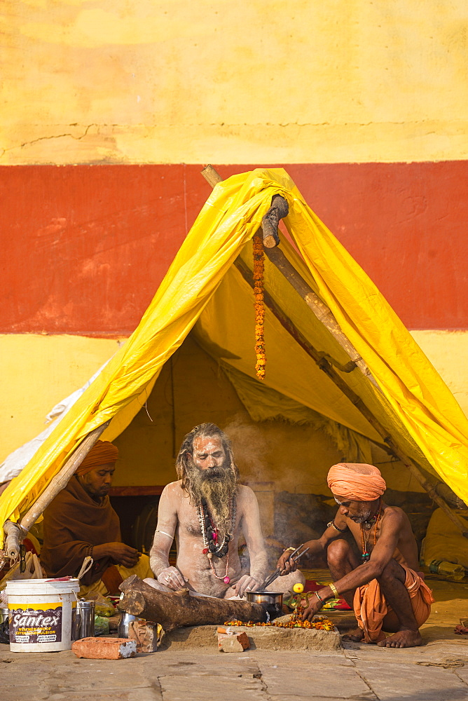 Hindu holy men sitting outside tent, Southern Ghats, Varanasi, Uttar Pradesh, India, Asia