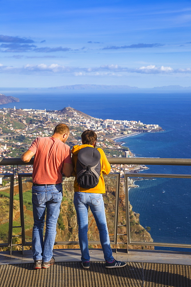 Tourists look at view from glass bottomed skywalk, Cabo Girao, Funchal, Madeira, Portugal, Atlantic, Europe