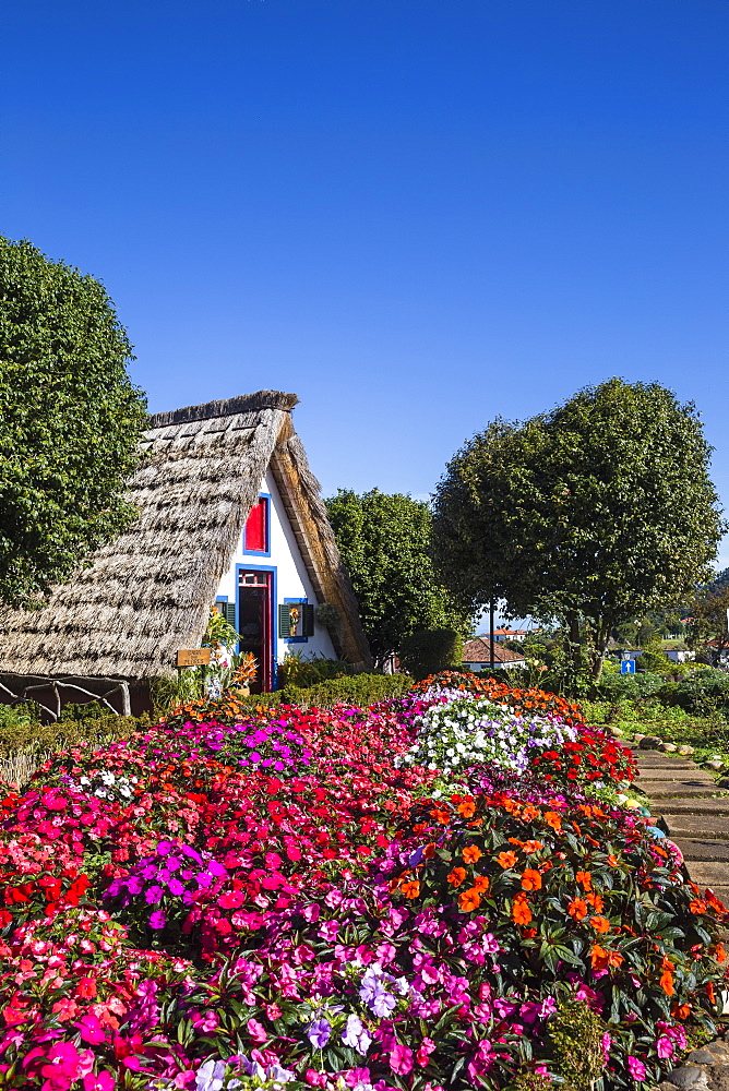 Portugal, Madeira, Santana, Traditional hous with steep, triangular-shaped thatched roof