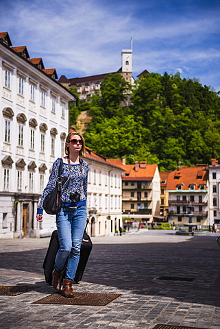 Tourist with suitcase, Ljubljana, Slovenia, Europe