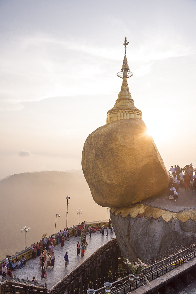 Pilgrims at Golden Rock Stupa (Kyaiktiyo Pagoda) at sunset, Mon State, Myanmar (Burma), Asia