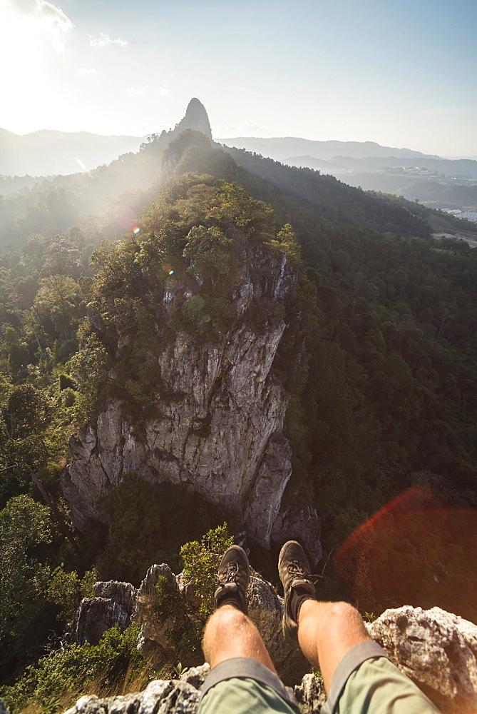 At the top of Bukit Tabur Mountain at sunrise, Kuala Lumpur, Malaysia