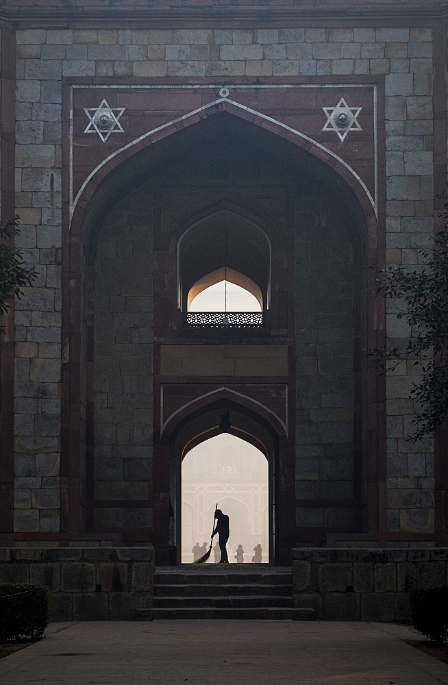 Silhouette of man sweeping under arch of Humayun's Tomb in Delhi, India, Asia - 1111-51