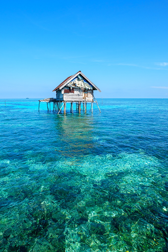Huts built over the water by the Bajau Fishermen who live there three months of the year, Togian Islands, Indonesia, Southeast Asia, Asia - 1111-93