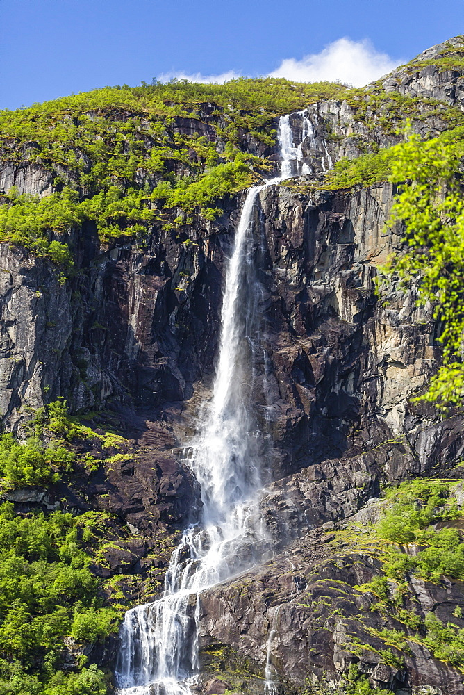 Ice melt waterfall on the Olden River as it flows along Briksdalen, Olden, Nordfjord, Norway, Scandinavia, Europe