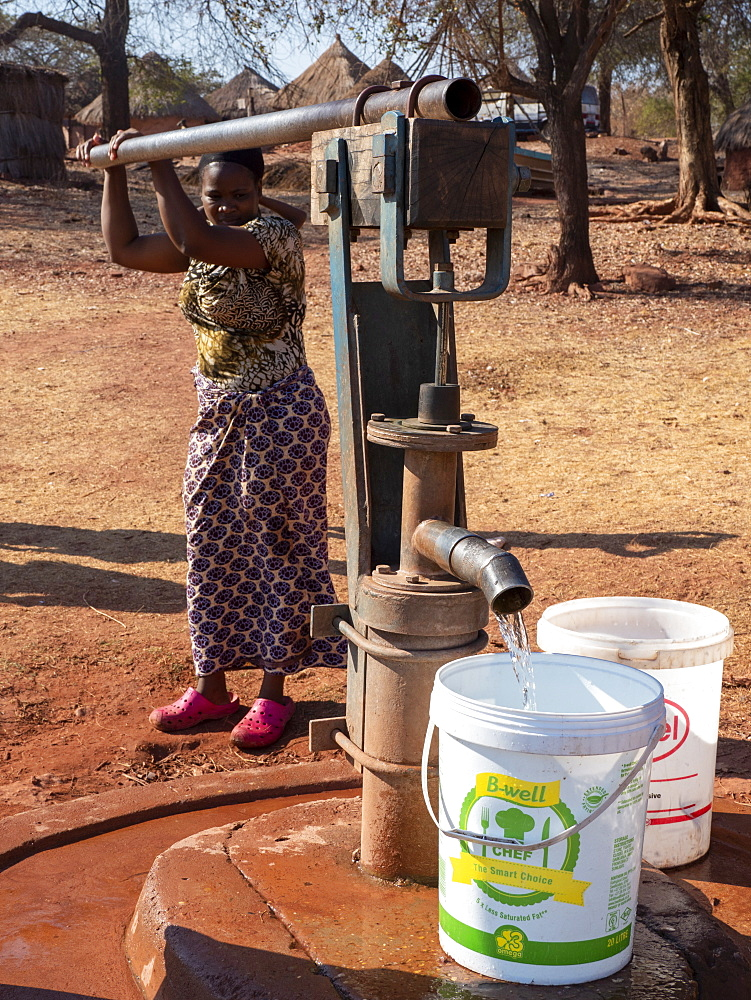 Pumping fresh water from a well in the fishing village of Musamba, on the shoreline of Lake Kariba, Zimbabwe.