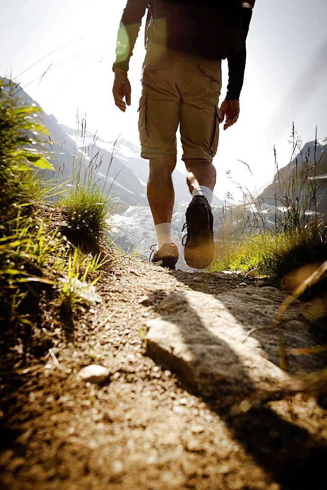 Hiker on mountain trail, on the way to Schreckhorn hut, Lower Grindelwald glacier, Bernese Oberland, Switzerland - 1113-104601