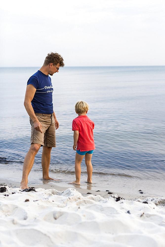 Father and son on the beach, dream beach between Strandmarken und Dueodde, sandy beach, summer, Baltic sea, Bornholm, Strandmarken, Denmark, Europe, MR - 1113-105096
