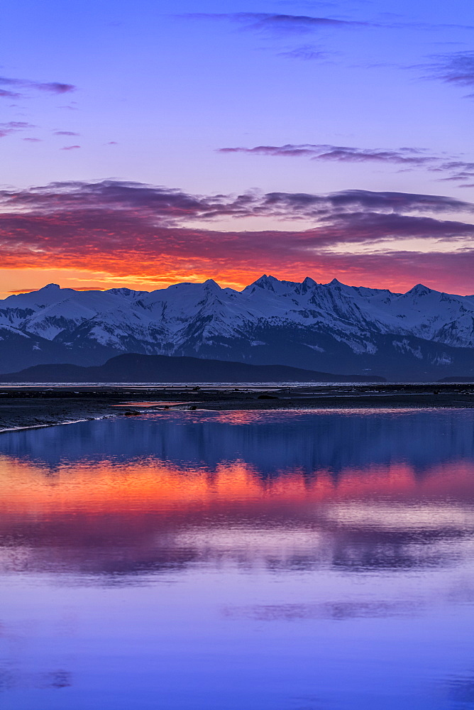 Eagle River and Eagle Beach during a brilliant coloured sunset and Chilkat Mountains, Juneau, Alaska, United States of America