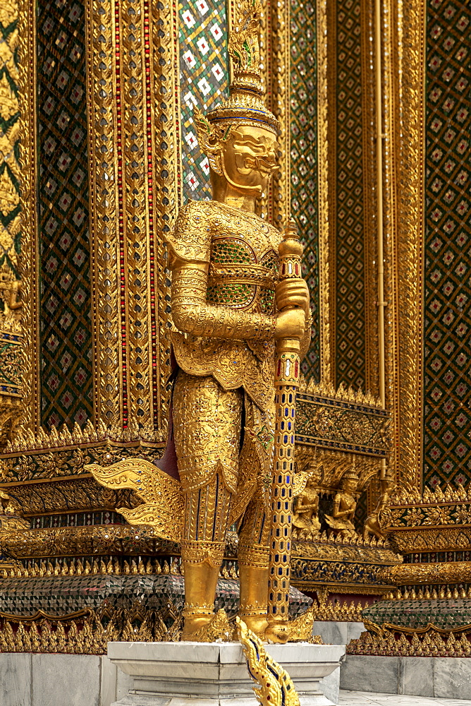 Temple of the Emerald Buddha golden guardian statue, Grand Palace, Bangkok, Thailand